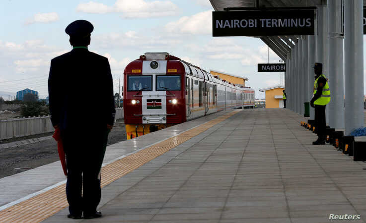 FILE - A train launched to operate on the Standard Gauge Railway (SGR) line constructed by the China Road and Bridge Corporation (CRBC) and financed by Chinese government arrives at the Nairobi Terminus on the outskirts of Kenya's capital Nairobi, Ma